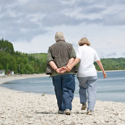 Senior couple on rocky beach